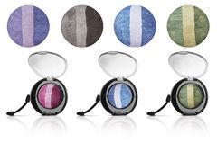 Mixed colors of solid eyeshadows collection, in black flat box with transparent lid and isolated samples, beauty products isolated. On white background royalty free stock images