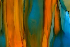 Mixed colors watercolor texture background. Hand drawn orange and navy smears, splashes abstract backdrop, alcohol ink.
