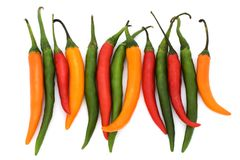 Mixed coloured chilli peppers Stock Photography