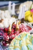 Mixed colourful gourmet ice cream sweet gelato in shop display Stock Photo