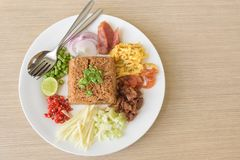 Mixed cooked rice with shrimp paste sauce Stock Image