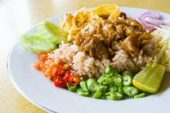 Mixed cooked rice with shrimp paste sauce on table Stock Photos