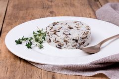 Mixed cooked rice with thyme on white plate Royalty Free Stock Photos
