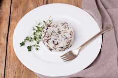 Mixed cooked rice with thyme on white plate Stock Photos