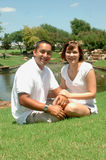 Mixed Couple. Happy married couple sitting in a park. Mixed diverse American couple Royalty Free Stock Photo