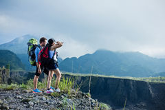 Mixed couple go trekking together, nature background Stock Photo