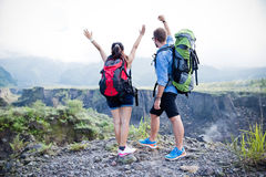Mixed couple go trekking together, nature background, winning ha Stock Photos