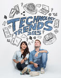 Mixed couple thinking about technology trends, illustrated thing Stock Photography