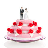 Mixed couple on top of wedding cake Royalty Free Stock Images