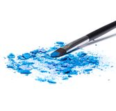 Mixed crushed compact blue eyeshadow different shades Royalty Free Stock Photos