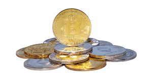 Mixed Crypto Currencies. Cryptocurrency physical gold bitcoin coin on bitcoins. Money concept stock photos