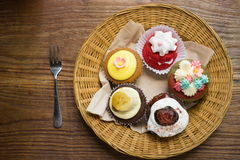 Mixed cupcakes. On wood table Stock Photo