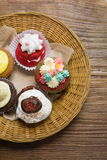 Mixed cupcakes. On wood table Stock Images