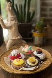 Mixed cupcakes. On wood table Royalty Free Stock Image