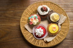 Mixed cupcakes. On wood table Royalty Free Stock Photography