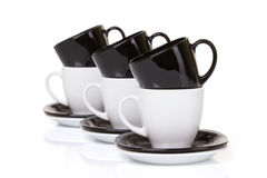 Mixed cups on the stack of the plates. Stock Photo