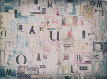 Mixed Cutout Fonts Abstract Background. Creative multilayered backgrounds made of torn newspaper and magazine pieces Royalty Free Stock Images
