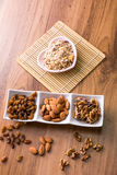 Mixed delicacies. Walnut, currant, almond on wooden worktop Stock Photos