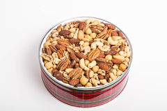 Mixed Deluxe Nuts In A Red Gift Tin Royalty Free Stock Photography
