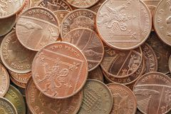 British Coins. Mixed denomination low value British currency. Two and one pence coins in a horizontal format. Full frame background royalty free stock photography