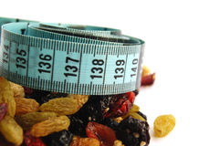 Mixed Dieting. This is an image of a measuring tape and an assortment of dried berries stock photo