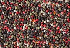 Mixed of diffrent kind peppercorns. Background Stock Photo