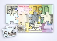 Mixed Dollar and Euro Note Puzzle. From top with a single separate euro piece Royalty Free Stock Photo