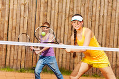 Mixed double tennis partners waiting for ball Stock Photos