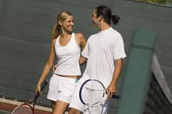 Mixed Doubles Partners standing on Court Royalty Free Stock Image