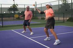 Mixed Doubles Pickleball Action - Forehand for the Point Stock Photography