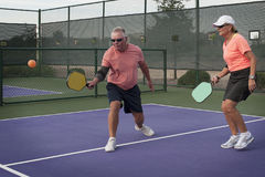 Mixed Doubles Pickleball Action - Smooth Backhand Royalty Free Stock Photos