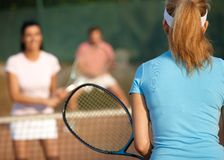 Mixed doubles tennis game Stock Photo
