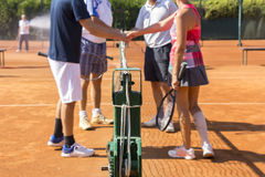 Mixed doubles tennis players shake hands before and after the te Royalty Free Stock Photography