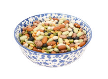 Mixed dried beans in a blue and white china bowl. Mixed dried beans - black turtle beans, flageolet beans, pinto beans, brown beans, haricot beans and split peas stock images