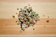 Mixed dried beans and peas on a wooden background Royalty Free Stock Image