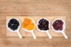 Mixed dried fruit and berries in ceramic ramekins Stock Images