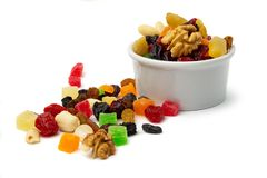 Mixed dried fruit and nuts in cup on white background. Isolated Royalty Free Stock Image