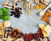 Mixed dried fruits. And nuts on a stone background stock photo