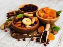 Mixed dried fruits. On a old white wooden table stock photography