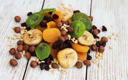 Mixed dried fruits. On a old wooden table royalty free stock photos