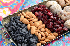 Mixed dried fruits and nuts in oriental style Stock Image