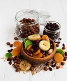 Mixed dried fruits. On a old white wooden table stock images