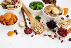 Mixed dried fruits. On a old white wooden table royalty free stock photo