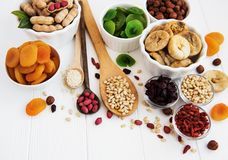 Mixed dried fruits. On a old white wooden table stock image