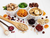 Mixed dried fruits. On a old white wooden table royalty free stock photography