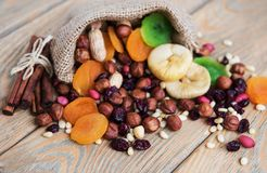 Mixed dried fruits. On a old wooden table stock photography