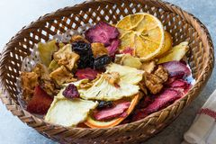 Mixed Dried Fruits Orange, Strawberry, Pineapple, Cherry and Apple Slices with Cinnamon Powder in Wooden Basket Royalty Free Stock Photos