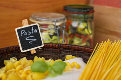 Mixed dried pasta selection with basil,Italian food Royalty Free Stock Photography
