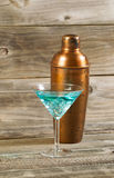 Mixed drink and Metal Mixer on Rustic Wood Royalty Free Stock Image