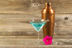 Mixed drink and Single Flower on Weathered Wood Royalty Free Stock Images